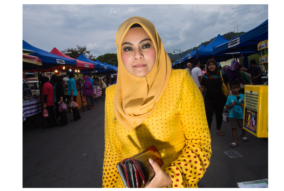 Muslim woman in yellow in Langkawi, Malaysia